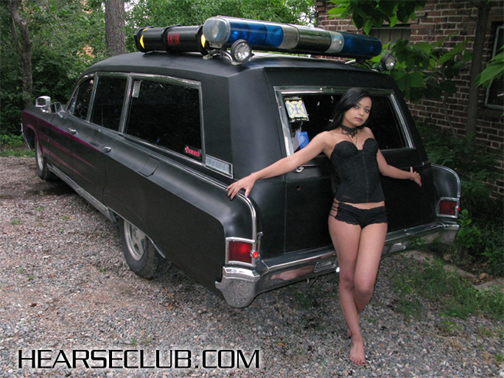 Not everyone is willing to pose with a hearse.